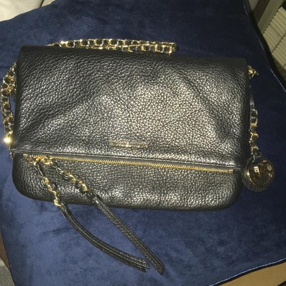 87721bb6ec8b0a Michael Kors leather crossbody purse. M_5c53988f2beb79e7e784fee1